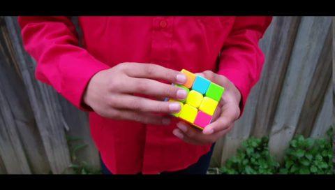 Kid Solving Rubik'S Cube 3X3